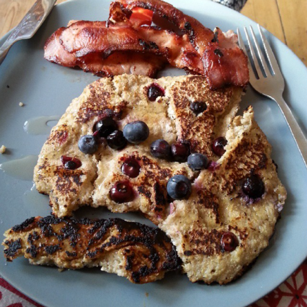 Quinoa flakes, 2 egg whites, almond milk and chia seeds, topped with blueberries. Nom dot com! (Ignore the bacon, naaat so healthy!)